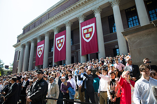 Harvard University celebrates Commencement 2014. Spectators watch from the steps of Widener Library. Stephanie Mitchell/Harvard Staff Photographer